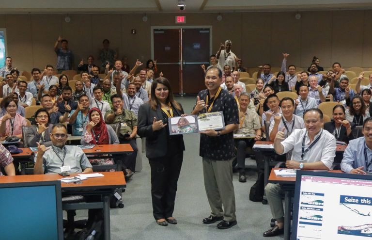 "DKI APCSS Director Pete Gumataotao presents Ms. Saira Ali Ahmed with her Alumnae of the Year certificate, shortly after presenting her Fellows project entitled ""From Strategy to Reality"" to ASC 18-2 in the auditorium."