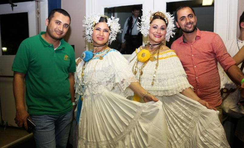Jordanian Army First Lieutenants Zaid AL-Awawdah (far left) and Basil Al-Amro (far right) pose next to a couple of Panamanian Folk Dancers who performed at the San Antonio Folk Dance Festival