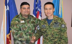 Capt. Camilo A. Bonilla Bernal, Colombian Army and Senior Chief Petty Officer Kwi Seong Lee, South Korean Navy