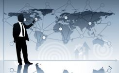 Image of man pointing to network map