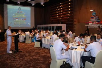 Gulf of Thailand Maritime Initiative 6th Commanders' Forum attendees listening to a briefing from a THAI-MECC officer on how Thailand conducts interagency coordination on maritime law enforcement activities. (Photo by THAI-MECC)