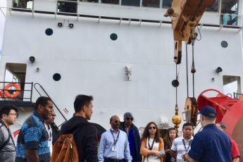 DKI APCSS Fellows observe the heavy lifting and transport equipment US Coast Guard uses to effect aids to navigation or pollution response at sea.