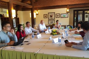 Lt. Cmdr. Leah Cole (APCSS Military Fellow) and Dr. Tran Viet Thai (Deputy Director General, Diplomatic Academy of Vietnam) co-facilitate a working group discussion to identify which changing dynamics in the region are of greatest concern to Vietnam, to d
